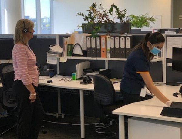 Woman cleaning the workplace