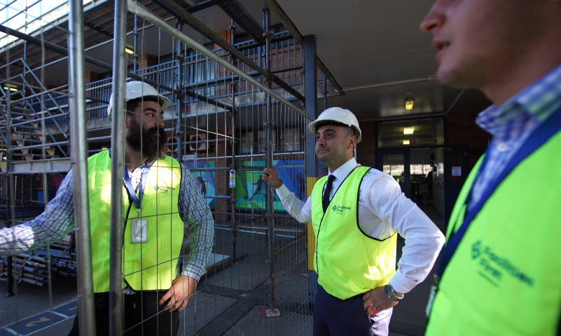 Men on construction site reviewing work | Facilities First