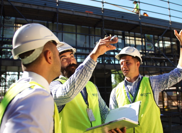 Group of men discussing at the construction site