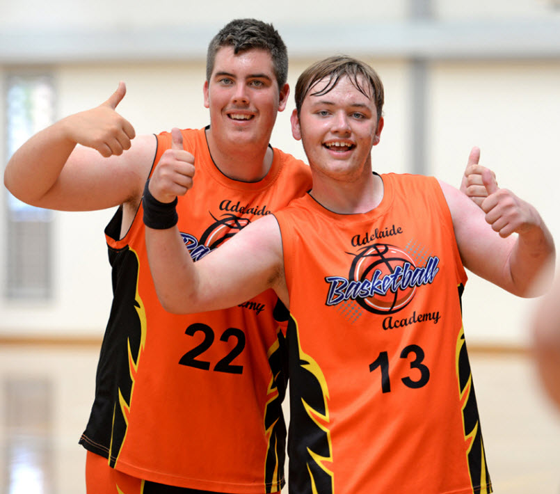 Two boys wearing jersey happily smiling at the camera