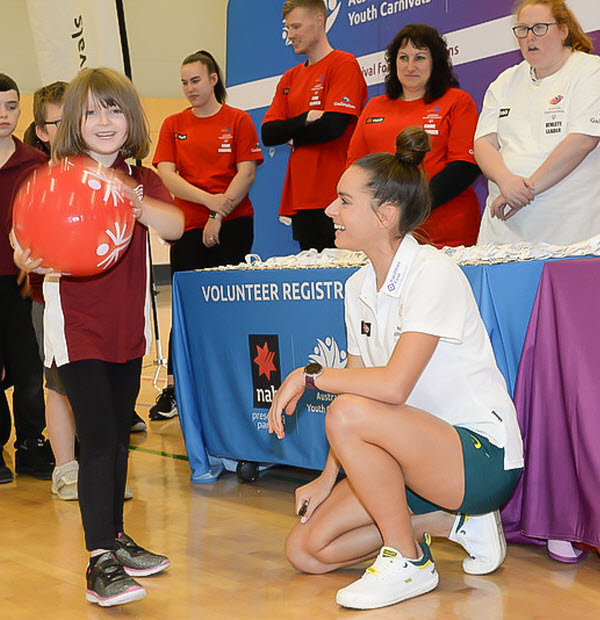 Young lady meets an olympian